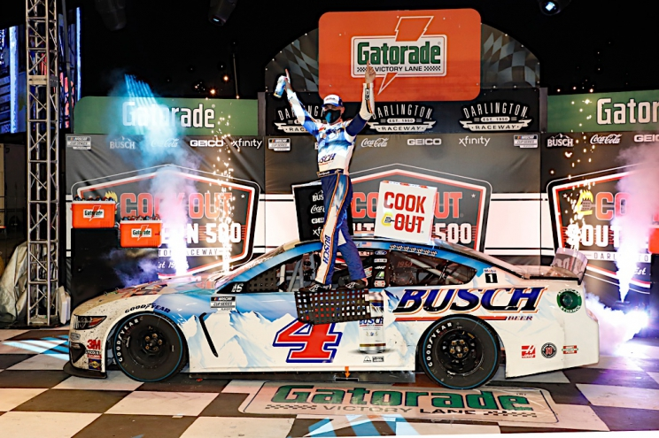 Harvick wins playoff opener